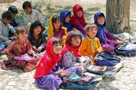 education school children sitting in the shade of an orchard in bamozai near gardez paktya province