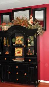 ideas china hutch decor pinterest: fall decorating for china cabinet like the idea of adding seasonal decor to the top and changing the color of the knobs adds to it