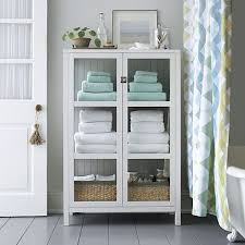 shop kraal white cabinet finished in fresh white this clean lined and classic cabinet has paned glass on three sides for a light and airy look bathroom furniture ideas