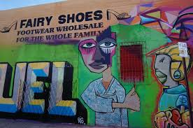 photo essay street art in wynwood buddy the traveling monkey what i love the most about the area is the variety of styles and designs and you can t forget to look down there s even art on the sidewalk