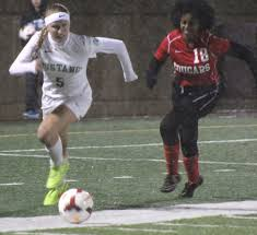 mounds view moves into semifinals after defeating centennial mounds view s rachel boyer 5 races away from a centennial defender and toward the cougars goal in the second half of the mustangs 2 0 victory wednesday