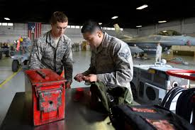 u s department of defense photo essay air force airman 1st class cody howard left and senior airman alexander lopez pick