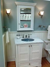 bathroom place vanity contemporary: bathroom white wooden vanity with white counter top and sink placed on the brown wooden