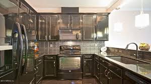 art deco kitchen with inset cabinets undermount sink pendant light metal tile art deco kitchen lighting