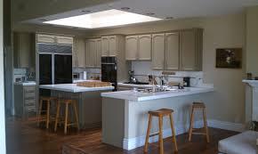 dishy kitchen counter decorating ideas:  woood kitchen island beige tile floor kitchen countertop design ideas l shape brown wood kitchen cabinet light brown laminate wood floor white dish rack