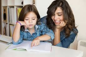Two Parents Stock Photos Images  Royalty Free Two Parents Images        RF com two parents  Mother helping her little child with homework