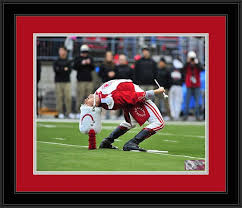 cornhusker marching band drum major at ucla game         college   ohio state buckeyes   marching band   drum major back bend   framed picture