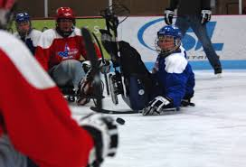 u s department of defense photo essay a veteran participating in a game of sled hockey falls on his back while hustling for
