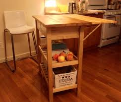 leaf kitchen cart: left and right hinge supports were attached to the outside of the cart legs and the bottom of the shelf scrap wood was again used between the support and