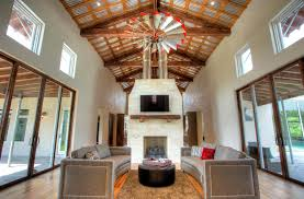 cool ceiling fans living room farmhouse with area rug curved sofas baseboards ceiling fan