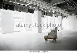 file boxes on cart in empty office stock image boxes stack office file