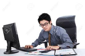 young male entrepreneur sitting in the office while doing his stock photo young male entrepreneur sitting in the office while doing his job computer calculator and documents
