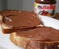 Risultati immagini per Immagini di bimbi che mangiano pane e Nutella gif