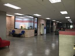 they have polished concrete floors and exposed electrical tubes for that distinct industrial feel red bricks with exposed white grout serving as accent accent office interiors