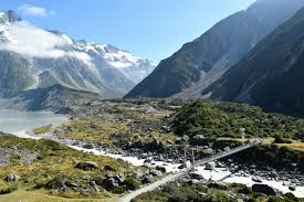 two week new zealand road trip a photo essay   native traveler hiking the hooker valley track in aorakimount cook national park with amazing glaciers topping the southern alps in the background