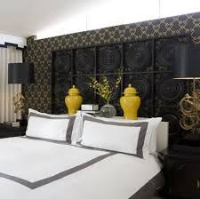 yellow and gray bedroom: via desire to inspire black yellow and gray bedroom colors love the glossy lacquer yellow ginger jars and white bedding with gray frame
