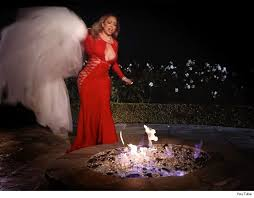 Image result for Mariah Carey burns N125m wedding dress