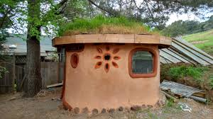 a fish tank in the wall a grass roof earthen floor led lights embedded into the stainglass and is super cozy the dome sauna is outside adobe tank san francisco ca