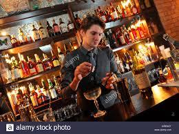 bar manager nicolas de soto mixes a calvados based cocktail at ecc bar manager nicolas de soto mixes a calvados based cocktail at ecc in town