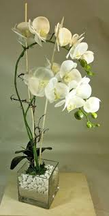 day orchid decor: artificial orchids in glass vase  artificial orchids in glass vase