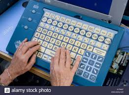 a pensioner using a specialised intellikeys large keyboard while a pensioner using a specialised intellikeys large keyboard while learning computer skills