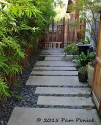 path of poured concrete and mexican beach pebbles colorful la garden of potted maven annette bedroommagnificent lush landscaping ideas