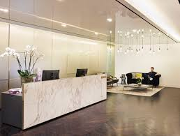 the spacious reception area gives off the vibe of a luxury boutique hotel best office reception areas