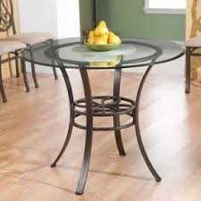person dining room table foter: grace your home with the true elegance of this dining table made out of sturdy four leg metal base and elegant durable glass top