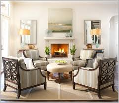small living room dual ottoman  chairs around an ottoman a perfect set up for a living room