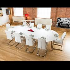 dining table that seats 10: large mm oval boardroom dining table set with  white chairs  quatropi