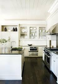 white kitchen cabinets dark floors design decorating