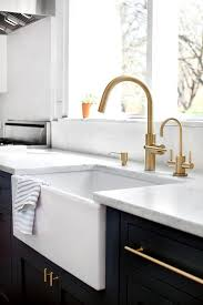 kitchen features navy blue shaker cabinets adorned