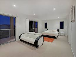colours for a bedroom: modern bedroom design idea with carpet amp french doors using black colours bedroom photo