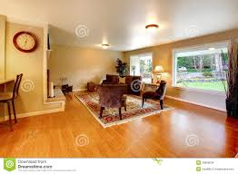 dining room khaki tone: elegant warm color furnished living room with wide windows stock images