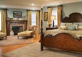 traditional bedroom traditional master bedroom idea in other with gray walls medium tone hardwood floors a bedroom compact black bedroom furniture dark