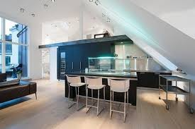 futuristic modern kitchen design under slanted roof with awesome lighting on kitchen island awesome lighting