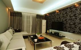 living room with bed: living room with l white sofa bed and glass top table also tv at abstract till