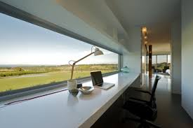 long white glossy wooden wall mount computer table in front of f large glass windos added chic ikea micke desk white