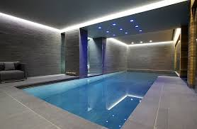 grey walls and recessed lighting give this indoor pool a minimalist appeal amazing indoor pool lighting