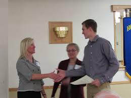home page rotary club of faribault christine shaffer presents the 2 500 scholarship award to tj hunt