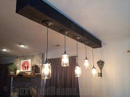 vintage style bell jar lights hung from a heavy sandblasted ceiling beam bell jar lighting fixtures