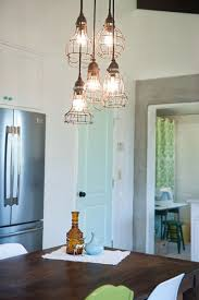 of course the kitchen isnt the only location that you can use a bare bulb pendant light another popular locations include flanking either side of a bare bulb lighting