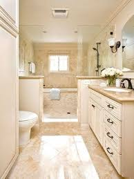 ideas bathroom tile color cream neutral: both the tub and shower in this upscale and practical wet room reside behind half walls and glass panels a mix of stone tile