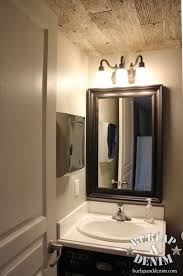 guest bathroom towels: vintage industrial guest bath with stainless paper towel dispenser