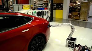 Charger prototype finding its way to Model S - YouTube