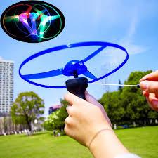 1PC Funny Spinning Flyer <b>Luminous</b> Flying UFO LED Light <b>Handle</b> ...