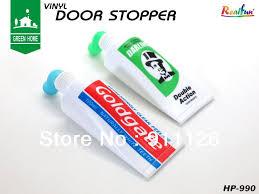 Aliexpresscom  Buy Free Shipping 2014 Novelty Toothpaste Door Stopper Vinyl Stops Creative Door Wedge Stop Holder Stylish Doorstop From Reliable