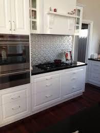 seams kitchen pinterest pressed tin pressed tin splash back  pressed tin splash back