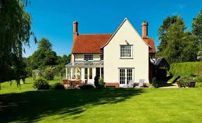 Things You Can Do Without Planning Permission   Homebuilding    traditional style home in the countryside built   planning permission