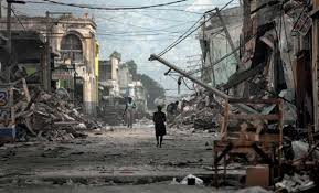 haiti earthquake of   britannica coma w  walking down a devastated street in port au prince  haiti
